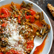 Healthy Sauteed green cicory and tomatoes topped with caccioricotta cheese - PhotoDune Item for Sale