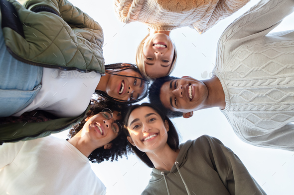 Happy joyful multiracial friends forming circle of heads - Stock Photo - Images