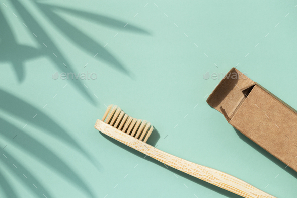 Bamboo Toothbrush with Plant Shadows. - Stock Photo - Images