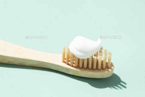 Bamboo Toothbrush on Mint Background. - Stock Photo - Images