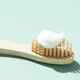 Bamboo Toothbrush on Mint Background. - PhotoDune Item for Sale