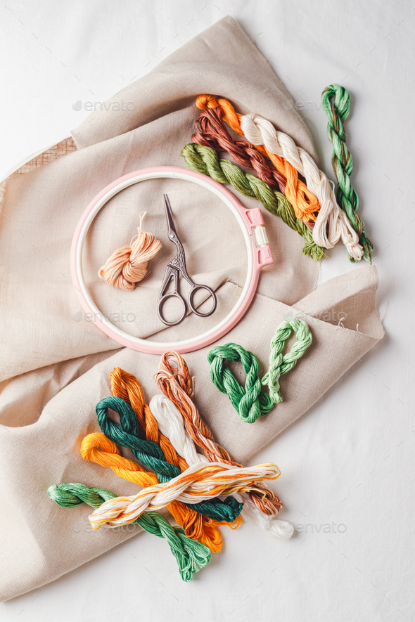 Embroidery set. Linen fabric, embroidery patterns, embroidery hoop, colorful threads and needls. - Stock Photo - Images