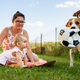 Adorable baby girl with mother and beagle family dog on colorful blanket on green grass. Child - PhotoDune Item for Sale