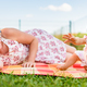 Adorable infant baby girl with mother on colorful blanket in green grass. Ninth months old child - PhotoDune Item for Sale
