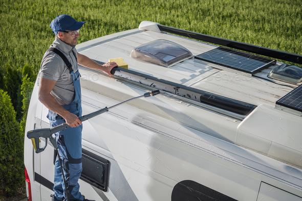 Smiling Caucasian Men Washing His Motorhome RV Camper Van - Stock Photo - Images