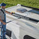 Smiling Caucasian Men Washing His Motorhome RV Camper Van - PhotoDune Item for Sale