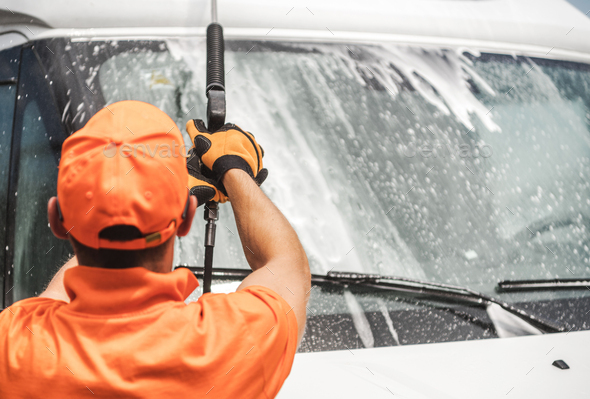 Worker Pressure Washing Commercial Vehicle - Stock Photo - Images