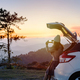 Young woman traveler looking beautiful landscape with car on road trip - PhotoDune Item for Sale