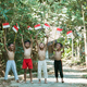 having fun group of kids standing without clothes when holding small the red and white flag - PhotoDune Item for Sale