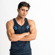 muscular man standing wearing gym clothes with crossed hands looking at the camera - PhotoDune Item for Sale