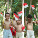 group of children walk holding small red and white flag together - PhotoDune Item for Sale