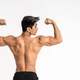 half body image of young man showing muscular body stand facing back - PhotoDune Item for Sale