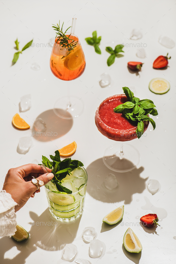 Poplular summer alcohol cocktails and womans hand with mint - Stock Photo - Images