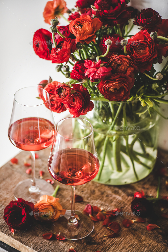 Rose wine in glasses and red spring flowers - Stock Photo - Images
