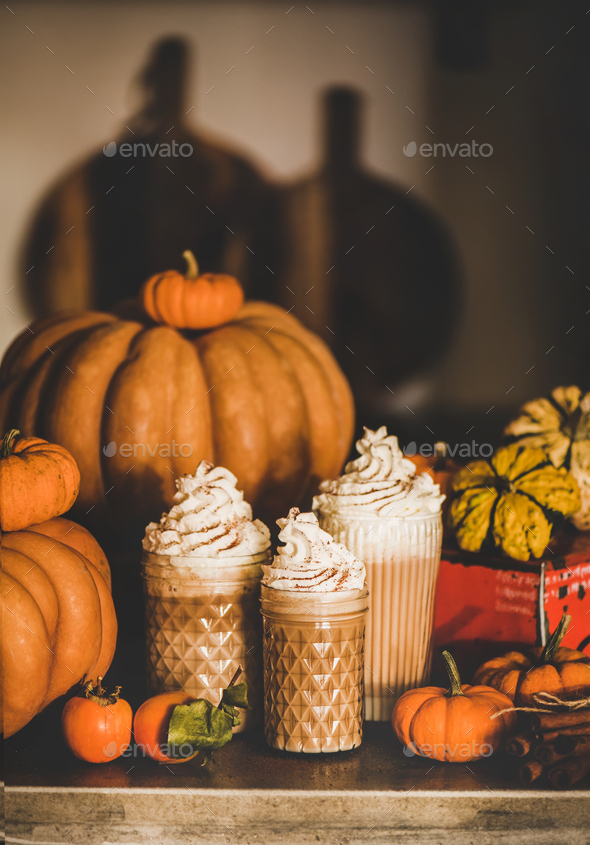 Pumpkin latte coffee decorated with whipped cream in glasses - Stock Photo - Images