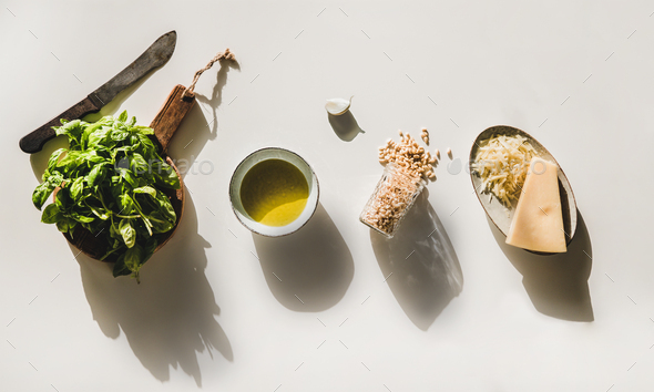 Basil, olive oil, Parmesan cheese and nuts for pesto sauce - Stock Photo - Images