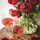 Rose wine in glasses and red spring flowers - PhotoDune Item for Sale