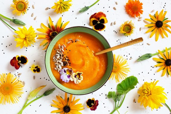 Pumpkin Creamy Soup decorated with Flowers - Stock Photo - Images