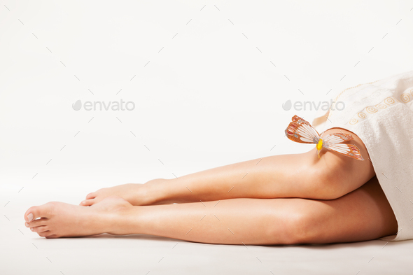 Beautiful woman legs with butterfly - Stock Photo - Images