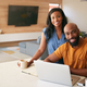 Portrait Of African American Couple Using Laptop To Check Finances At Home - PhotoDune Item for Sale