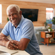 Portrait Of Senior African American Man Using Laptop To Check Finances At Home - PhotoDune Item for Sale