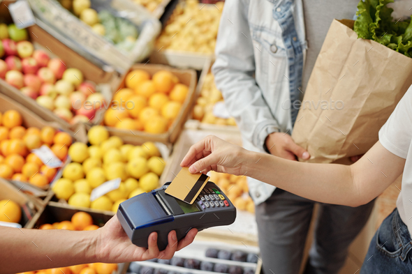 Using contactless payment at farmers market - Stock Photo - Images