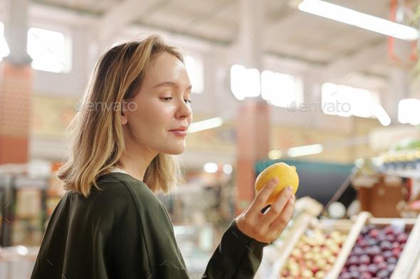 Buying lemon at fresh market - Stock Photo - Images
