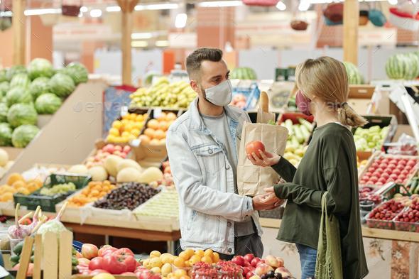 Buying organic food at market - Stock Photo - Images