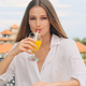 Beautiful girl drinking fresh orange juice on terrace with amazing view from villa on the hill - PhotoDune Item for Sale