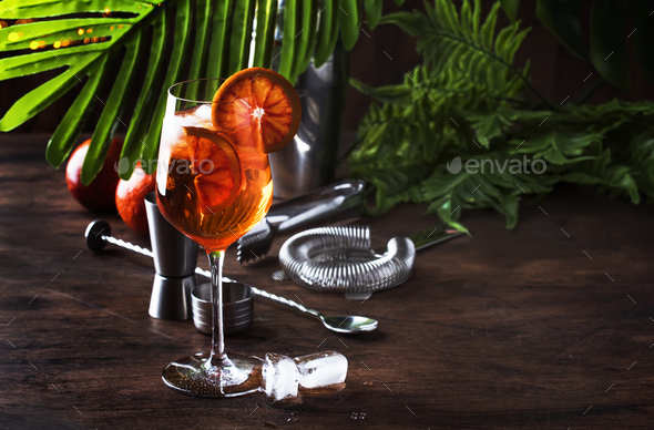 Aperol spritz cocktail in big wine glass with orange slices - Stock Photo - Images