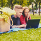 Attractive couple lying using a laptop on a picnic. - PhotoDune Item for Sale