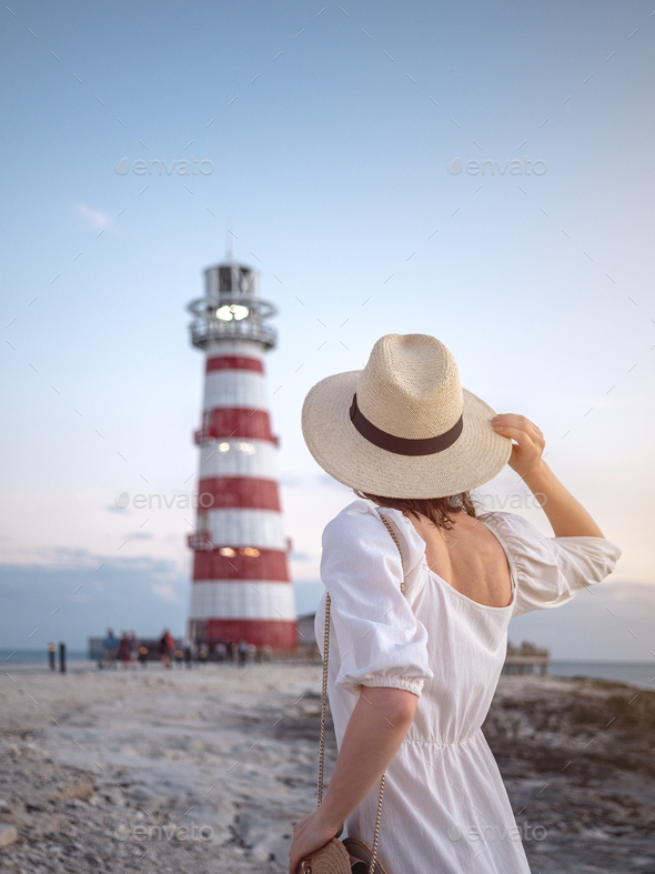 Young girl at the lighthouse - Stock Photo - Images