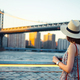 Young woman with a retro camera at the Manhattan Bridge - PhotoDune Item for Sale