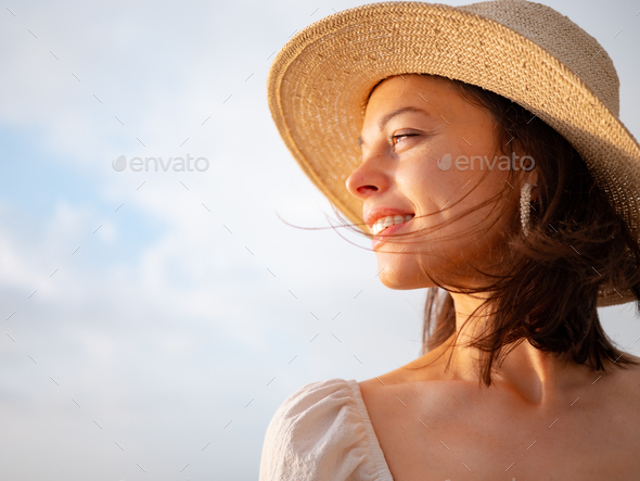 Smiling young woman outdoors - Stock Photo - Images