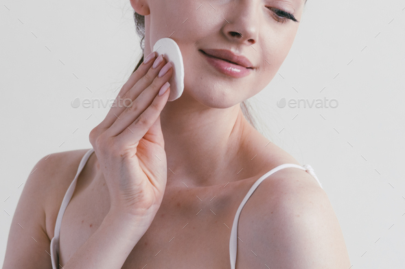 Cotton pad woman cosmetic concept clen skin makeup beauty face - Stock Photo - Images