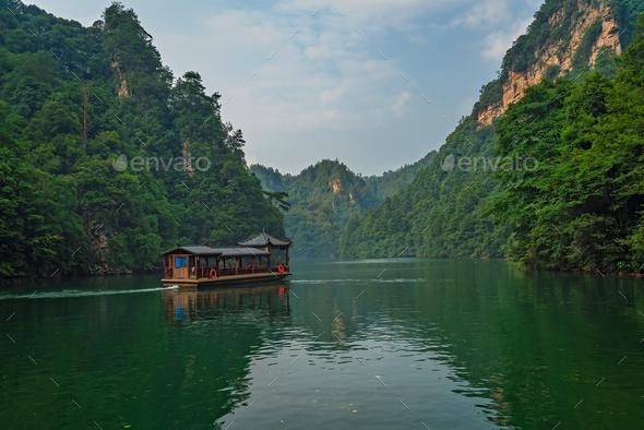Tourist boat sailing among karst landscape on Baofeng Lake - Stock Photo - Images