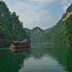 Tourist boat sailing among karst landscape on Baofeng Lake - PhotoDune Item for Sale