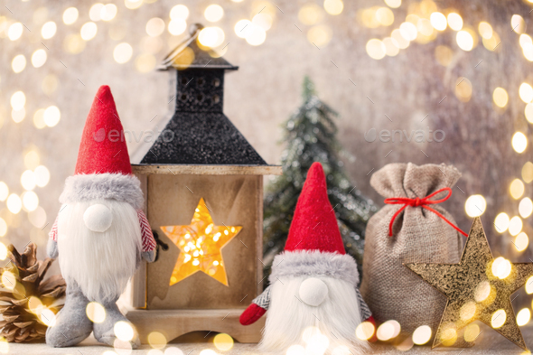 Christmas gnome und santa hat. Christmas pattern. Background on the gray color. - Stock Photo - Images