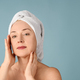 Portrait of cheerful woman with towel on head - PhotoDune Item for Sale