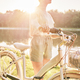 Close up of woman with bike by the lake - PhotoDune Item for Sale