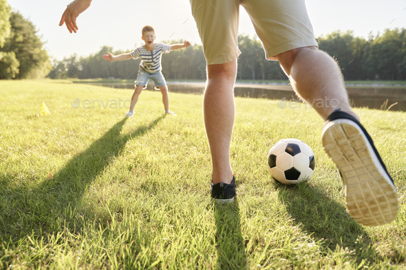 Two boys playing football in the garden - Stock Photo - Images