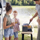 Family having barbecue during camper trip - PhotoDune Item for Sale