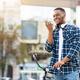 Portrait of african guy talking on phone using speaker - PhotoDune Item for Sale