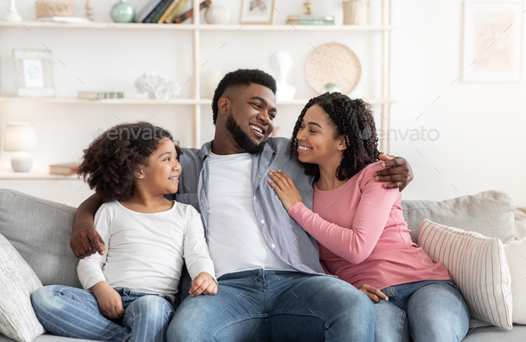 Family Home Leisure. Happy Black Parents And Little Daughter Relaxing On Couch