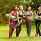 Full length portrait of diverse young women having friendly conversation after yoga class outside - PhotoDune Item for Sale