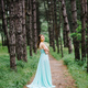 Happy girl in a turquoise long dress in a green park - PhotoDune Item for Sale
