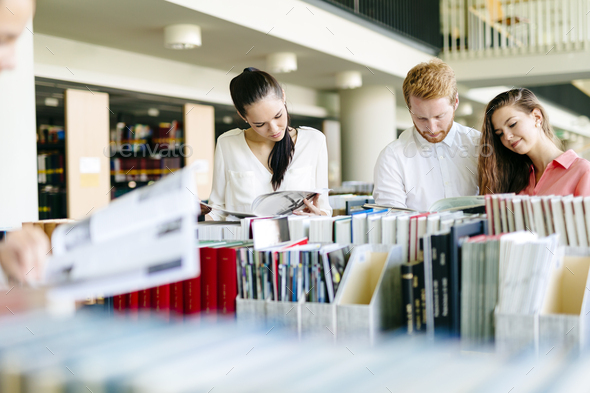 Group of students studying in library - Stock Photo - Images