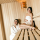 Two beautiful women relaxing in a sauna - PhotoDune Item for Sale