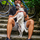 Male posing with his russel dog on stairs. - PhotoDune Item for Sale