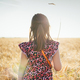 Little girl from the back on wheat field. Summer of autumn lifestyle. - PhotoDune Item for Sale